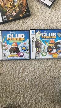 Two nintendo ds Club Penguin games with cases Ashburn, 20147