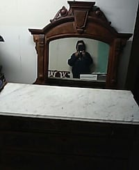 brown wood-framed mirror