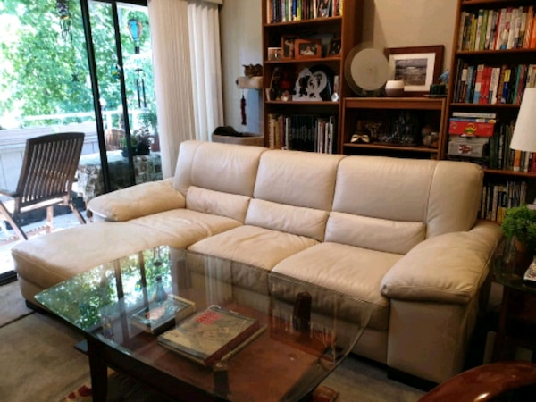 Couch: Italian off-white leather sofa w/LH chaise, excellent cond.