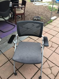 Gray plastic armchair with gray fabric padded seat