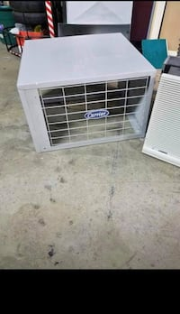 White lg window type air conditioner and heater combo