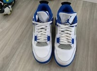 pair of white-and-blue Air Jordan 4 Manassas, 20110