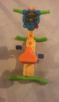 Mint condition Vtech ride  and learn Giraffe bike