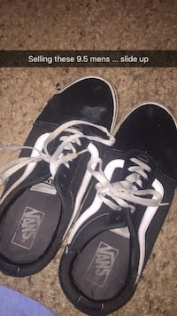 pair of black-and-white Vans sneakers 424 mi
