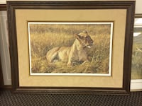 lioness surrounded by grass painting