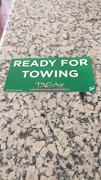 Aircraft tow sign