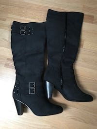 Pair of black side-zip boots size 9