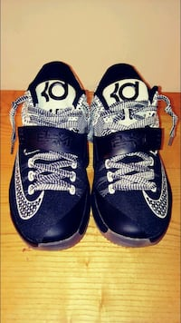 pair of blue Nike basketball shoes North Rose, 14516