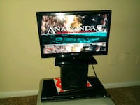 black flat screen TV with black wooden TV stand Houston, 77077