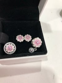 Authentic pandora magnolia 2 charms & 1 earrings. 90$ to all 3 Pickering, L1V 4V7