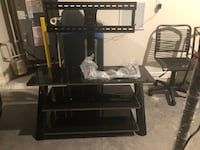 Excellent condition 65 inch tv mounting table  759 mi
