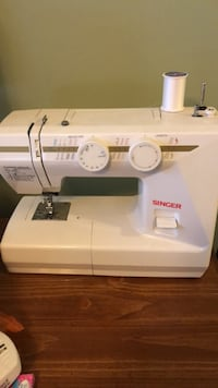 white Singer electric sewing machine with thread  Medina, 44256
