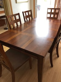 rectangular brown wooden table with six chairs dining set Calgary, T2J 0P6