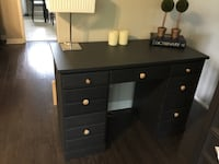 Older desk, fair condition.Exterior repainted gray. 7 drawers. Deliver