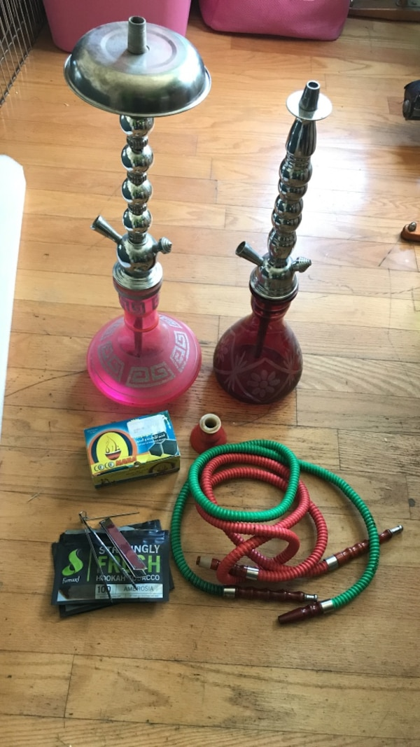 2 hookah bongs comes with a bowl, 2 hoses, a box of coals 2 pairs of tongs  and some tobacco