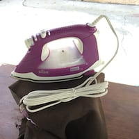 pink and white steam iron