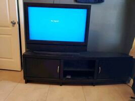 Tv with black tv stand Television