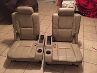 two gray leather car seats Houston, 77031