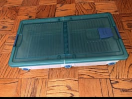 Blue and white plastic storage box with wheels