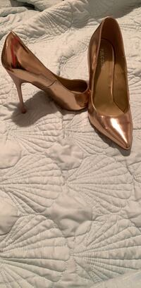 pair of brown leather peep toe platform stilettos New York, 11223