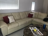 white leather sectional sofa with throw pillows