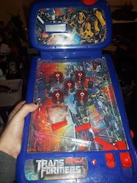 blue and red Transformers pinball machine
