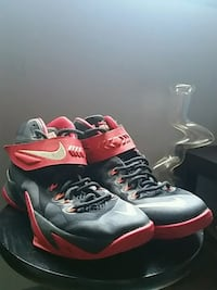 pair of red-and-black Nike basketball shoes Chestermere, T1X 0E5