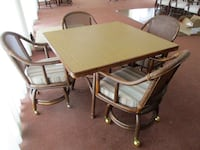 Rattan Table with Four Chairs on Casters