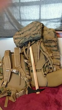 two brown-and-green camouflage hiking bags