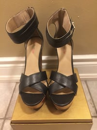 pair of black leather open-toe ankle strap heels Mississauga, L5V