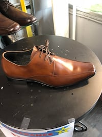 Pair of brown leather dress shoes Toronto, M6E 2G8