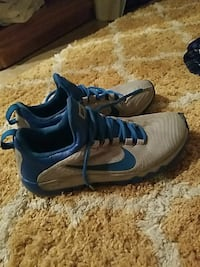 pair of gray-and-blue Nike shoes size 8