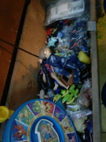 Box of toys from hot wheels to dora