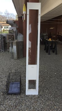 """IDEAL Pet Products Tempered Glass dog door heavy duty vertical length size is 80 inches and flap size is 7 X 12 """" with flap door closure Excellent condition  Height is adjustable at top Waretown, 08758"""