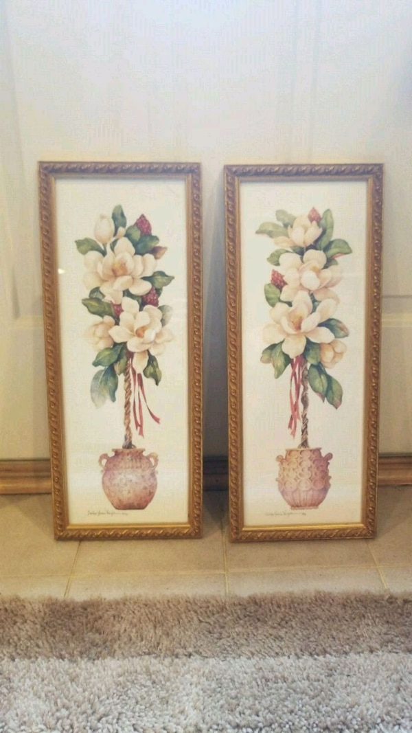 two gold wooden framed painting of flowers
