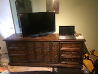 flat screen television and brown wooden dresser