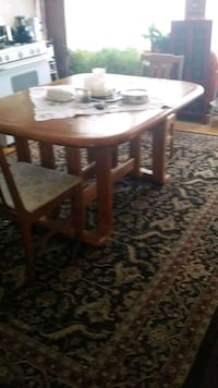 Large solid wooden table with 3 chairs  Shelbyville, 49344