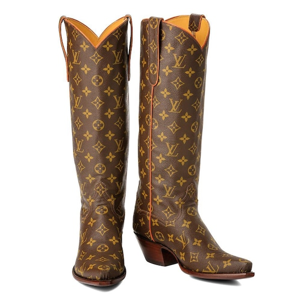 98a46dae61e pair of brown leather cowboy boots