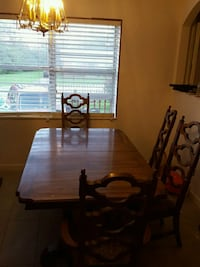 rectangular brown wooden table with six chairs din Calhoun, 30701