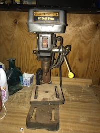 gray and brown Central Machinery drill press