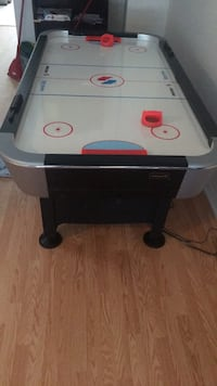 Black and white air hockey table