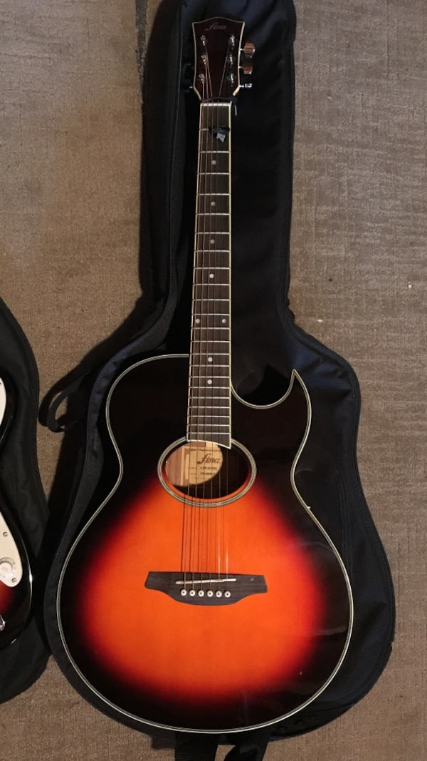 Used Black And Orange Acoustic Guitar For Sale In Hempstead Letgo