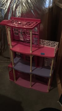 pink and purple plastic doll house 36 km