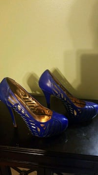 pair of blue leather peep-toe platform stilettos