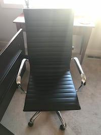 Black wheely office chair 3129 km