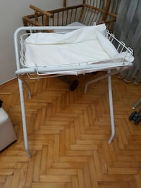 white metal diaper changing table