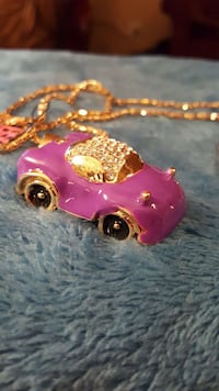 pink and gold-colored clear gemstone encrusted car pendant necklace