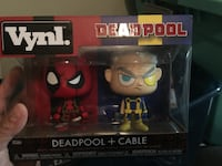 Vynl figures cable and deadpool Surrey