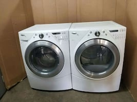 white Whirlpool clothes washer and dryer set