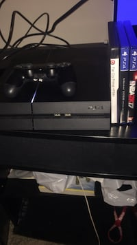 Black sony ps4 console with controller + 3 games